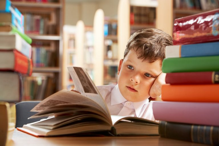 Kobi_Kid Reading A lot of books