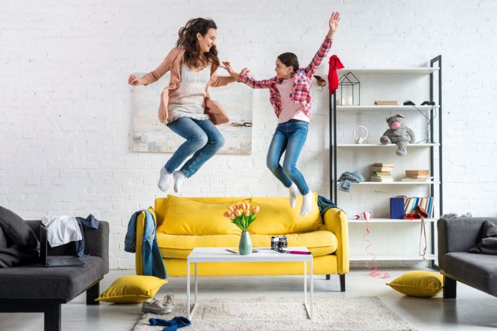 KOBI_kid jumping in the living room